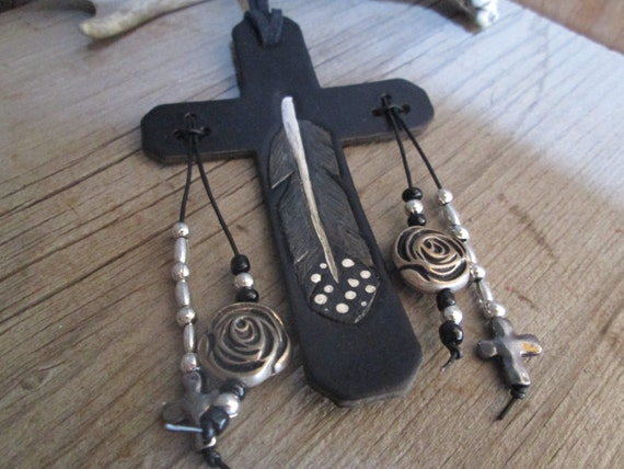 Black Leather Saddle Cross with Hand Tooled Feather