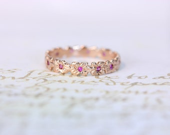beautiful detailed 14 kt gold plumeria band with pink sapphires