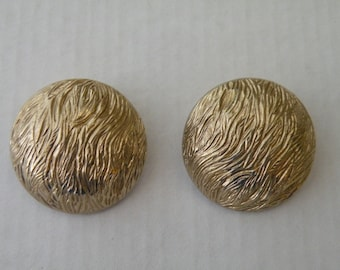 Monet gold tone button clip-on earrings.