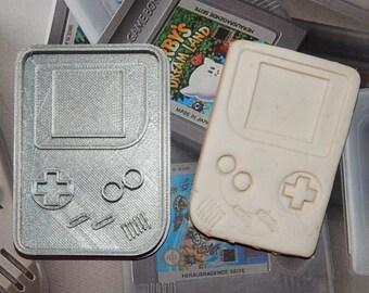 """Cookie cutter cookie """"Gameboy""""."""