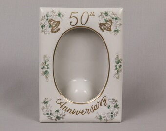 Lefton 50th Anniversity White China picture frame, built in easel Made in Japan, Red Label, Gold bells held by doves in 4 corners Pristine