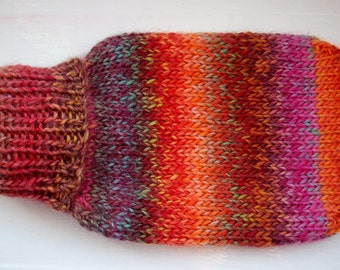 Hot water bottle and hand knitted cozy, hottie cover, medium, variegated orange, amber, pink, burgundy by SpinningStreak