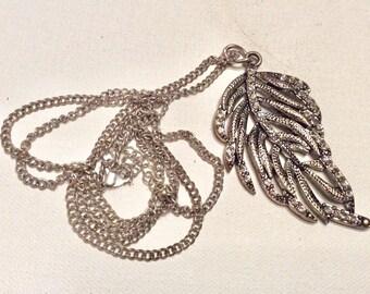 Vintage rhinestone feather pendant necklace.
