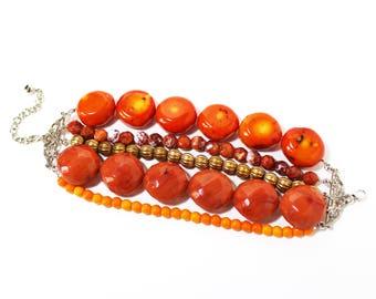 Orange tones beaded multi strand bracelet