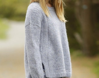 Woman alpaca and wool hand knitted sweater, with false raglan, vent and textured pattern on shoulders and sleeves