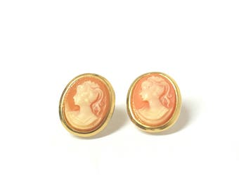 Vintage gold cameo stud earrings with peach female goddess silhouette