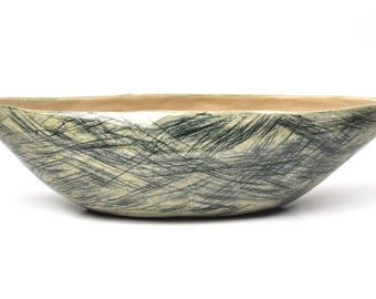 Stoneware boat shaped bowl