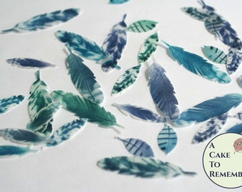 35 small wafer paper feathers. Purple, blue and green edible feathers, for a cupcake topper or cake pops.