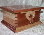 Rohan Jewelry Box with Rohan Horse Latch and Hinges. Two jewelry trays and secret compartments. Exotic Sapele wood and spalted birch.
