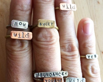 SHOUTOUT handforged sterling silver mixed metal stacking poetry rings.
