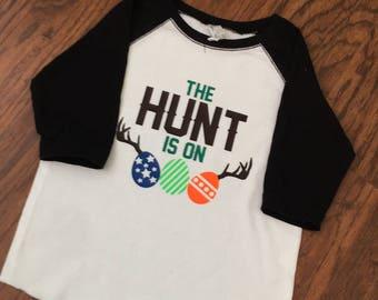 The Hunt Is On Easter Egg Toddler Raglan