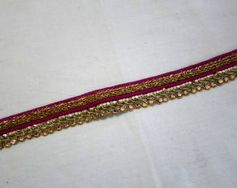Magenta and gold woven trim with crystals