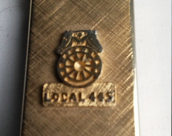 Vintage 14kt Gold Plated Slimline Lighter That is Embossed with the Symbol of the Teamsters  and Local 445