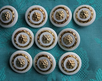 10 buttons in white and gold with lions head, probably vintage but unused, size 1 inch, 2,5 cm