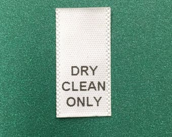 500 pcs of DRY CLEAN ONLY printed white satin care label