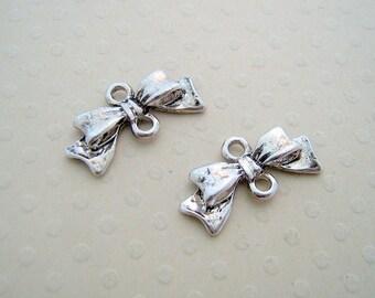 Set of 2 silver ribbon bow connectors antiqued 10 x 20 mm - CAV 0630