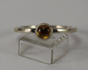 Hand fabricated sterling silver ring size 7 with citrine cabochon in bezel setting.