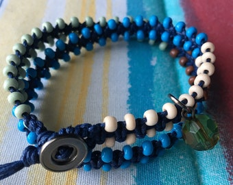 Dark blue cotton cord, blue, sage, and ivory color beads recycled charm and button boho wrap bracelet