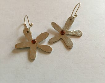 Silver hammered flowers with a copper rivet centre