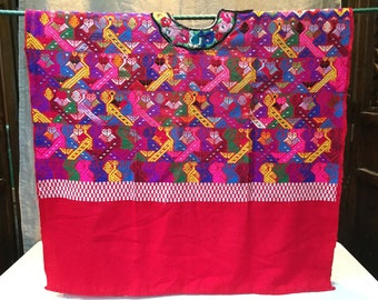 Vintage Guatemalan huipil with bright colors