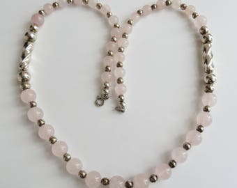 Light pink rose quartz & sterling silver bead 24 inch graduated necklace.