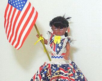 Ms. Amerika, musical doll plays God Bless America as she turns, great for July 4th.