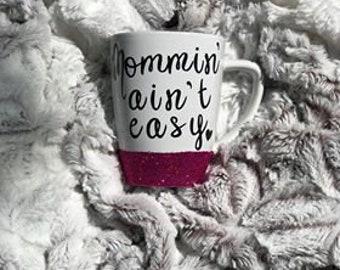 Mommin' ain't easy (glitter dipped coffee mug)