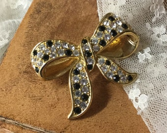 Elegant Black Clear Rhinestone Bow Brooch Pin Unsigned 1960's 1970's Gold Tone Metal Sparkling Bling Faceted Feminine Woman Day Evening Wear