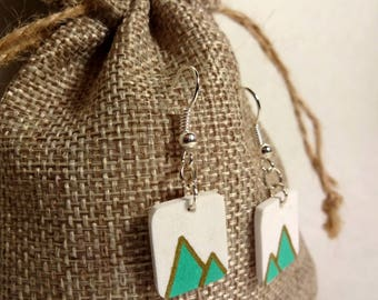 White earrings - lime green triangles.