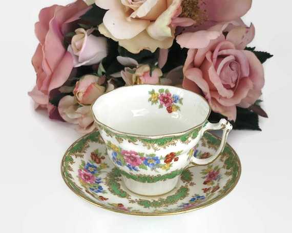 Old Royal China duo, cup and saucer, made in England, green and pink floral pattern on white background, pattern 2876, mid 20th century