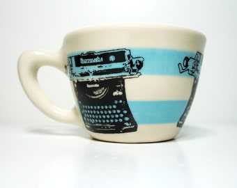 12oz cup featuring a burroughs typewriter, shown here on cloudless blue stripes - Made to Order / Pick Your Colour