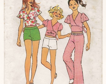 "A Short Flared or Puff Sleeve, Surplice Bodice Crop Top & Shorts and Flare Leg Pants Pattern for Girls: Size 7, Breast 26"" • Simplicity 6954"