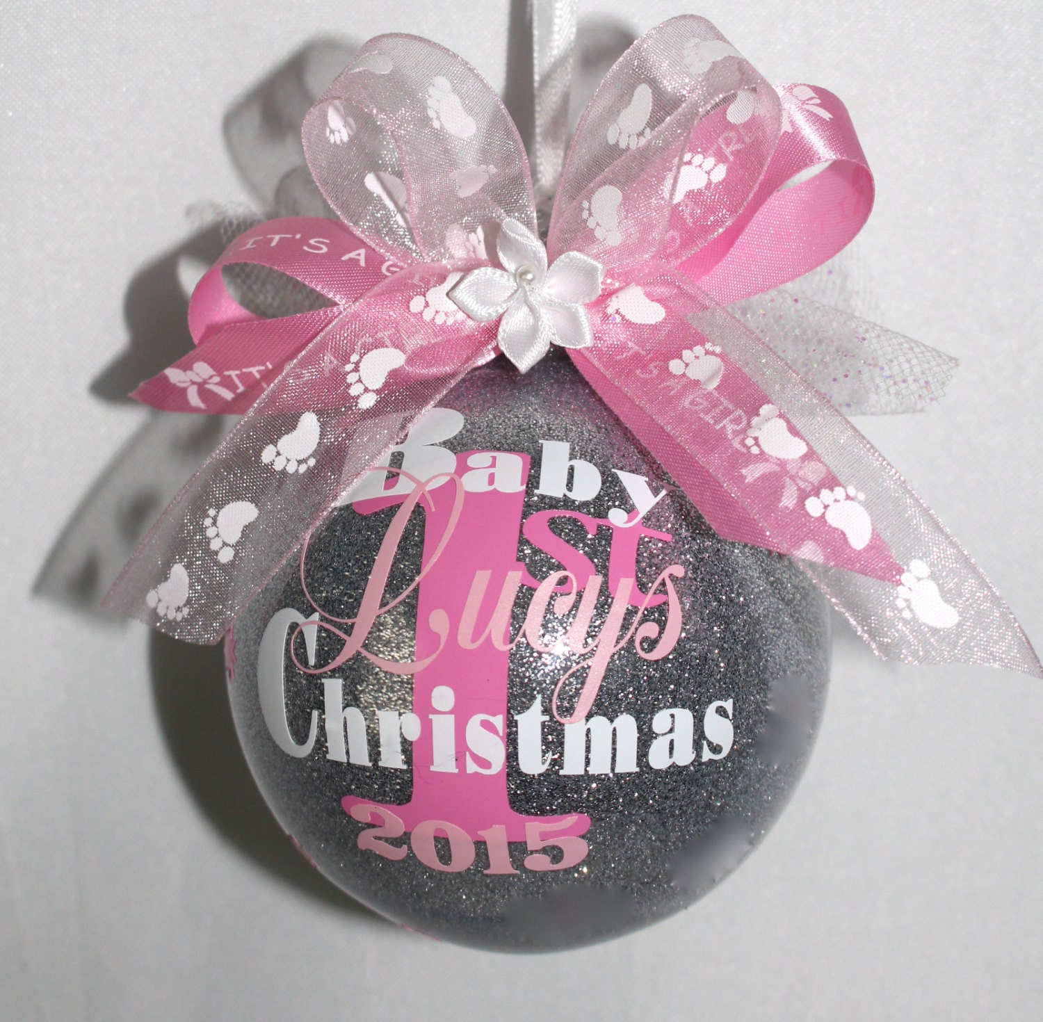 Baby\'s first christmas ornament personalized with year and
