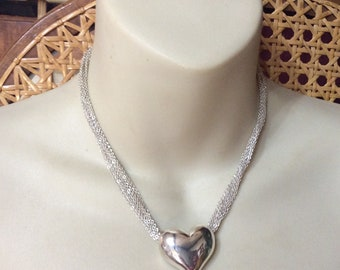 Silver heart multi chain silver metal necklace pendant.