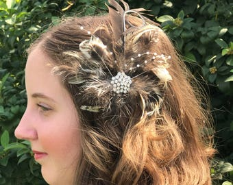 Natural pheasant feather fascinator hair clip eith craft pearls and a sparkling pendant