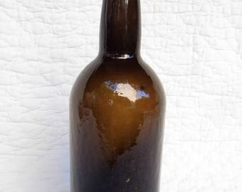 Old bottle from the end of 18th century or begin of the 19th in a amber green glass