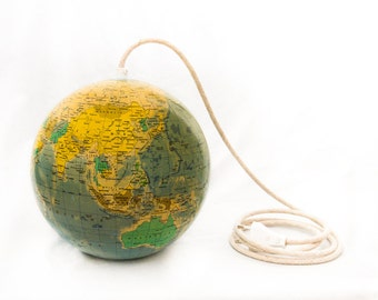 Lamp made of a vintage glass globe from 1984 with linen cord