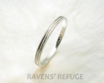 delicate 1.5mm platinum wedding ring with milgrain