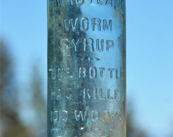 Antique 1800's quack medicine bottle WORM SYRUP Children cry for more embossed on it