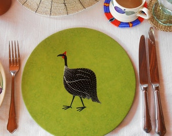 Round Placemats, Set of 4, hand decorated with Guinea Fowl, hand textured lime green and hand tied with a black ribbon