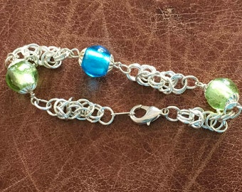 Glass bead bracelet with silver plated Byzantine weave chain