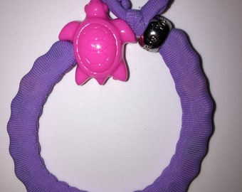 Small purple band with pink turtle