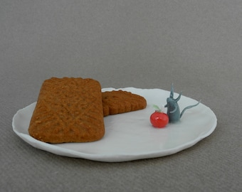 Spoon rest in white porcelain - trinket dish with a fantasy animal and a red apple