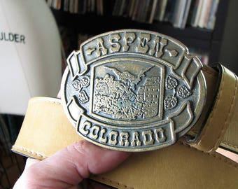 vintage vinyl belt with Aspen Colorado buckle, 70s brass buckle