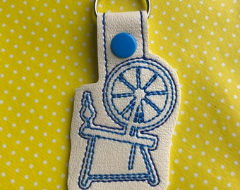 Spinning wheel embroidered key fob