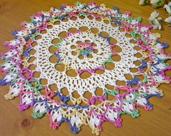 pastels and white crocheted doily