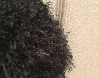 Black fuzzy knitted scarf