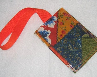 Crazy quilt luggage tag with orange strap