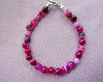 Pink agate bracelet with pewter clasp