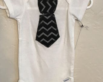 Onesie  with black chevron tie 6-9 month